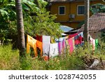 colorful linen is dried on a... | Shutterstock . vector #1028742055
