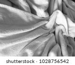 white wrinkled fabic texture... | Shutterstock . vector #1028756542