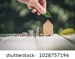 saving to buy a house or home... | Shutterstock . vector #1028757196