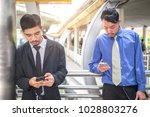 two businessman use smartphone... | Shutterstock . vector #1028803276