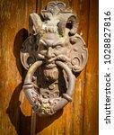 scary looking door knocker made ... | Shutterstock . vector #1028827816