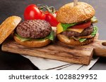 tasty grilled home made burgers ... | Shutterstock . vector #1028829952