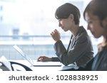 businesswomen working in the... | Shutterstock . vector #1028838925