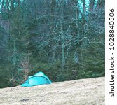 tent on a field in a forest in... | Shutterstock . vector #1028840506