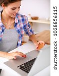 smiling woman online shopping... | Shutterstock . vector #1028856115
