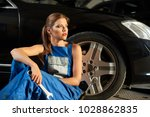 beautiful girl mechanic sits... | Shutterstock . vector #1028862835