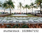setup wedding dinner | Shutterstock . vector #1028867152