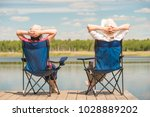 young relaxed couple near a... | Shutterstock . vector #1028889202