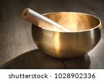 a tibetan singing bowl with a... | Shutterstock . vector #1028902336