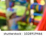 child on a bright playground.... | Shutterstock . vector #1028919466