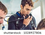 diving instructor helps a... | Shutterstock . vector #1028927806