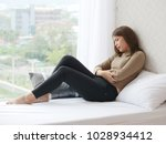 young asian woman in pain with... | Shutterstock . vector #1028934412