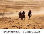 silhouette of massai boys... | Shutterstock . vector #1028936635