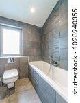 small modern nice bathroom | Shutterstock . vector #1028940355