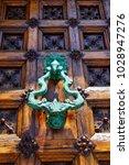 beautiful knocker on the door... | Shutterstock . vector #1028947276