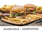 hamburgers and french fries on... | Shutterstock . vector #1028949505
