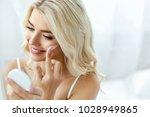 beauty face care. woman... | Shutterstock . vector #1028949865