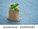 mint leaves in gunny sack on... | Shutterstock . vector #1028950282