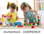 two kids playing with wooden... | Shutterstock . vector #1028965825