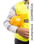 builder holding a yellow... | Shutterstock . vector #1028988226