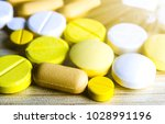 medicine pills or capsules on... | Shutterstock . vector #1028991196