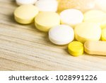 medicine pills or capsules on... | Shutterstock . vector #1028991226