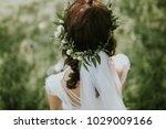wreath of flowers on the head....   Shutterstock . vector #1029009166