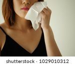 young woman remove make up by... | Shutterstock . vector #1029010312