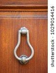 knocker in metal on old wooden... | Shutterstock . vector #1029014416