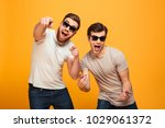 portrait of a two cheerful... | Shutterstock . vector #1029061372