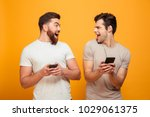 portrait of a two happy young... | Shutterstock . vector #1029061375
