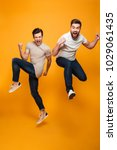 portrait of a two cheerful... | Shutterstock . vector #1029061435