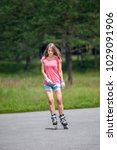girl roller skating in the park ... | Shutterstock . vector #1029091906