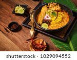 egg noodle in chicken curry ... | Shutterstock . vector #1029094552
