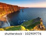 cliffs of moher at sunset  ...   Shutterstock . vector #102909776
