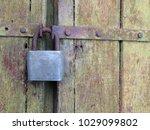 rusty lock on an old wooden... | Shutterstock . vector #1029099802