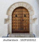 ancient engraved wooden  doors... | Shutterstock . vector #1029103312