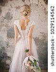bride's back in lace dress with ... | Shutterstock . vector #1029114562
