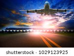 plane flying and airport... | Shutterstock . vector #1029123925