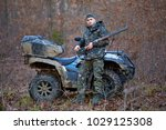 young hunter on a quad bike... | Shutterstock . vector #1029125308