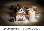 gingerbread house candle on... | Shutterstock . vector #1029129478