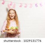 easter celebration. child is... | Shutterstock . vector #1029131776