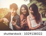 group of teenage asian friend... | Shutterstock . vector #1029138322