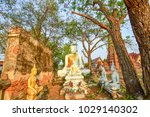 the old buddha statue on the... | Shutterstock . vector #1029140302