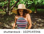 young woman wearing a swimsuit... | Shutterstock . vector #1029145546