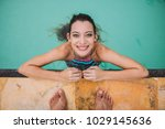 young woman on the pool ... | Shutterstock . vector #1029145636