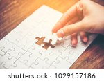close up of hand placing the... | Shutterstock . vector #1029157186