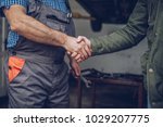 the auto mechanic is shaking... | Shutterstock . vector #1029207775