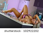 sexy blonde girl in kitchen | Shutterstock . vector #102922202