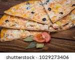 pizza with pineapple on a...   Shutterstock . vector #1029273406